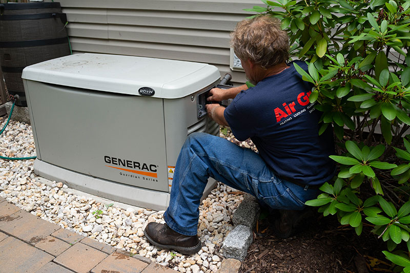 Air Group Electrician Installing A Generator